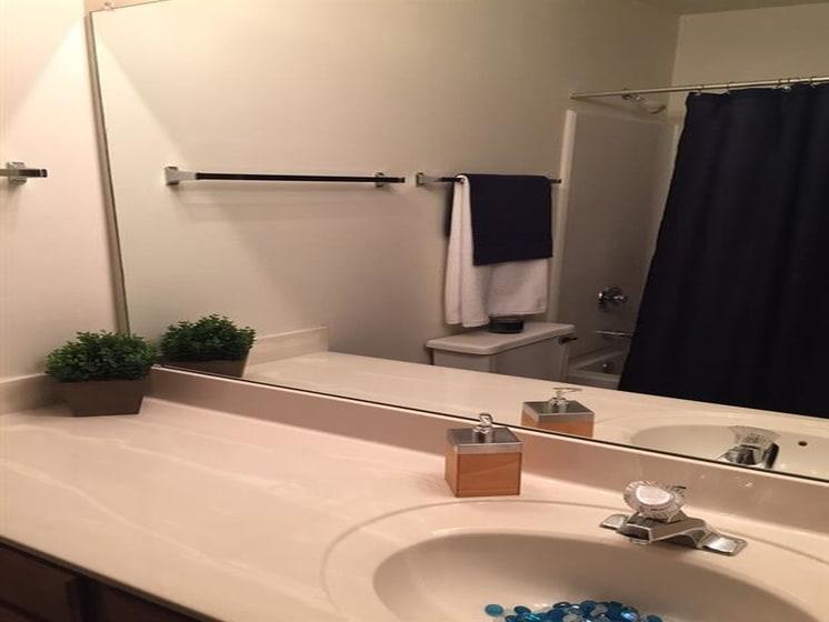 Granite Counter-tops In All Bathrooms at Deer Run Apartments, Brown Deer, WI