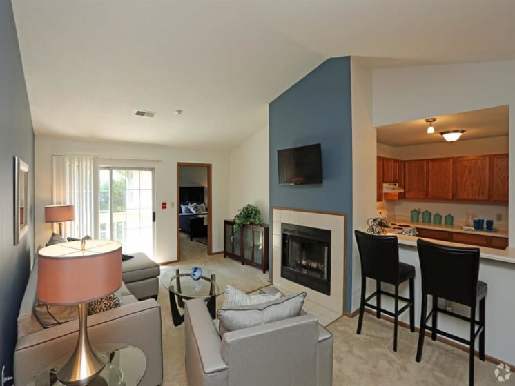 Living Room View With Fireplace And Eating Area at Deer Run Apartments, Wisconsin