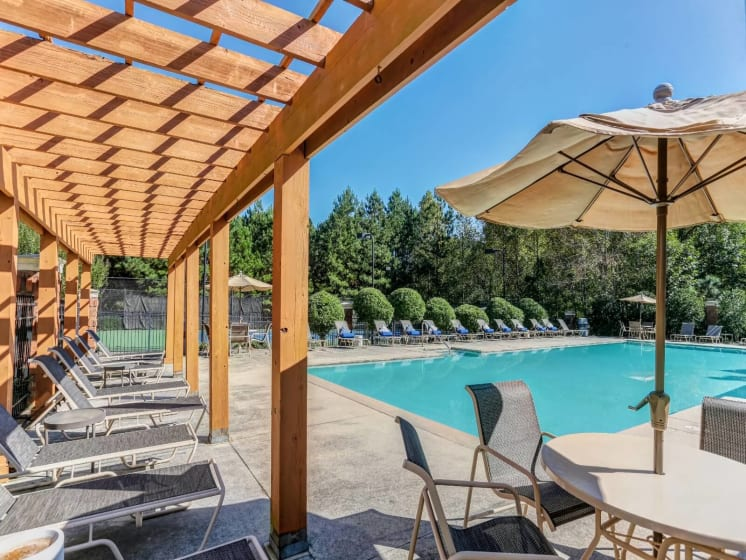 Relaxing Pool Area With Sundeck at Tramore Village Apartment Homes, Austell, Georgia