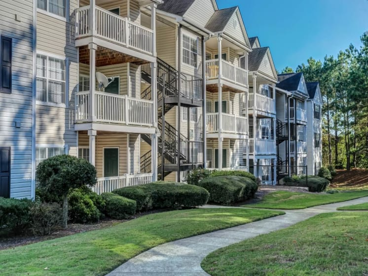 Front View of Building at Tramore Village Apartment Homes, Austell, GA