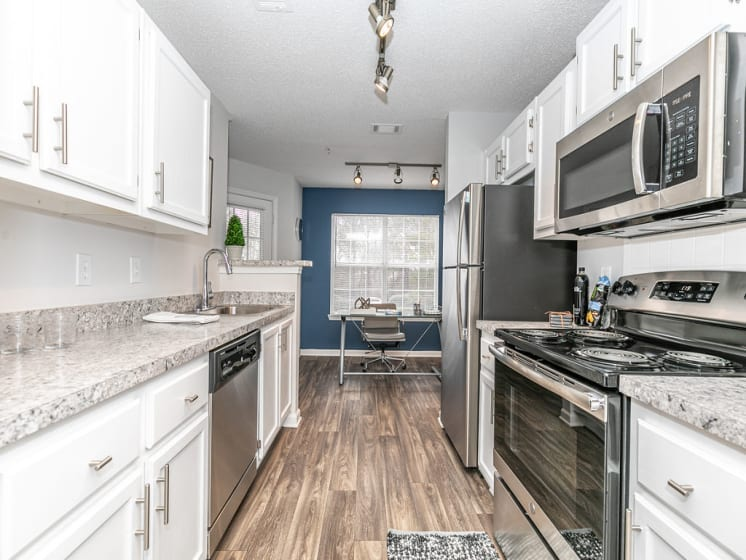 Fully Equipped Kitchen at Tramore Village Apartment Homes, Austell, GA, 30106