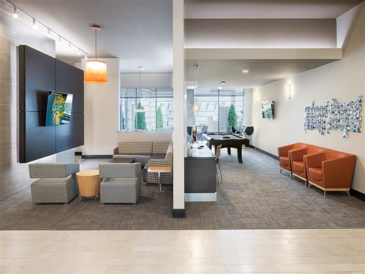 Clubhouse Lounge with Billiards Room at The Edison Lofts Apartments, Raleigh, NC