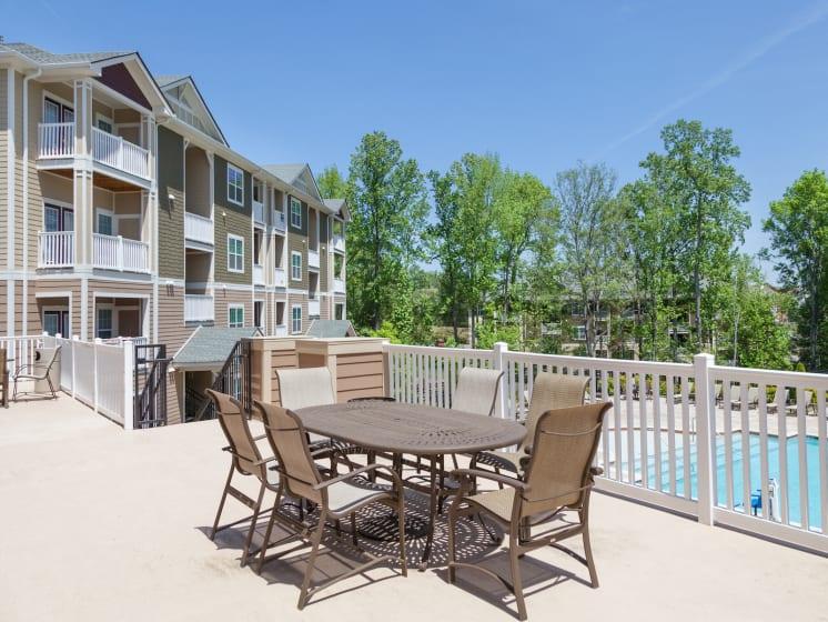 Outdoor Dining Area at Phillips Mallard Creek Apartments, North Carolina 28262