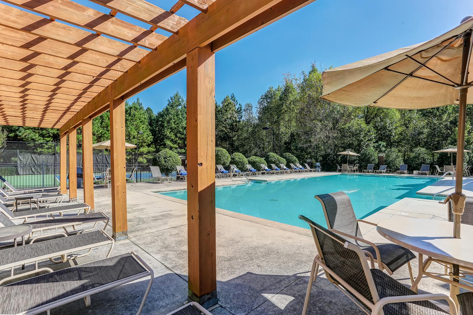 Poolside Sundeck With Relaxing Chairs at Tramore Village Apartment Homes, Austell, GA, 30106