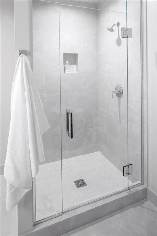 Walk-In Showers With Built-In Bench And Glass Enclosure at Two Lincoln Tower, Bellevue, WA, 98004