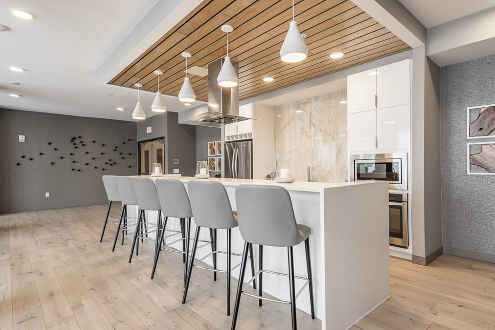 View of gourmet kitchen and bar stools in amenity space at The Preserve in Bloomington
