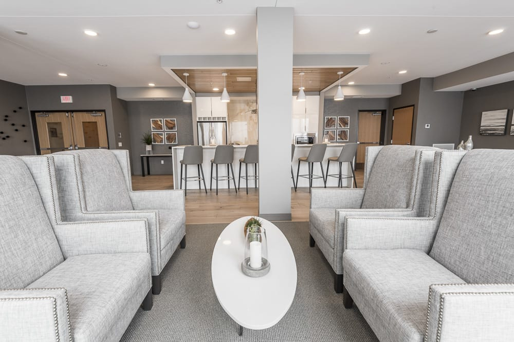 View of gray seating near the gourmet kitchen in The Preserve's amenity space