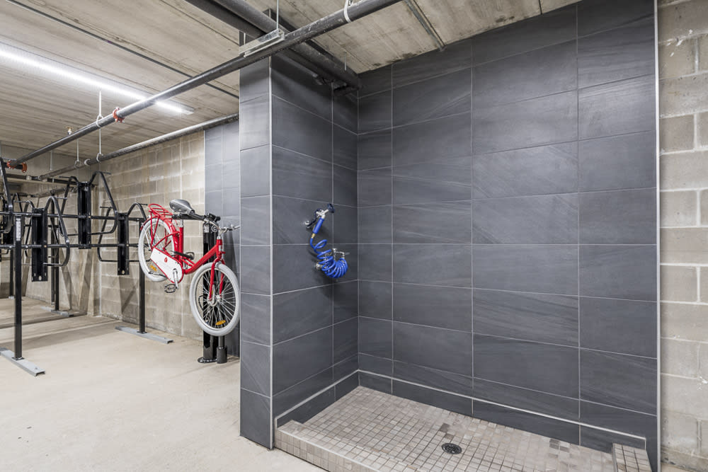 Bike wash station next to bicycle storage at The Preserve at Normandale Lake