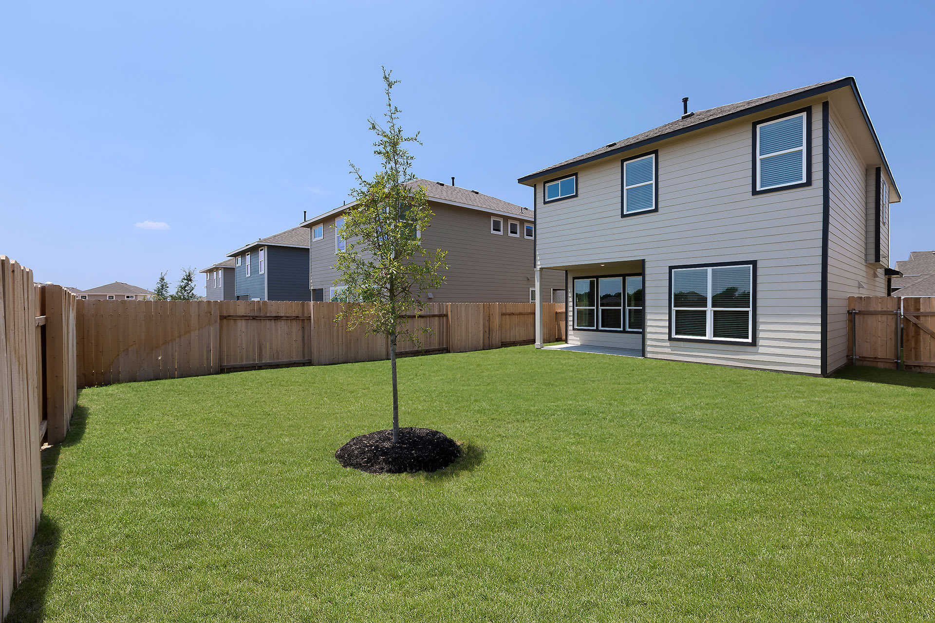 Rivers Edge Apartments Private, Fenced Backyards with Grass