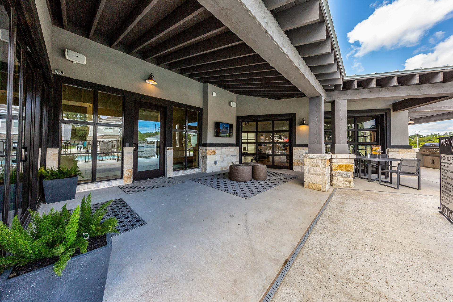 Rivers Edge Apartments Patio Seating with Barbecue Grills