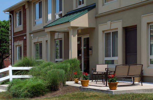 outdoor seating area in front of apartment complex