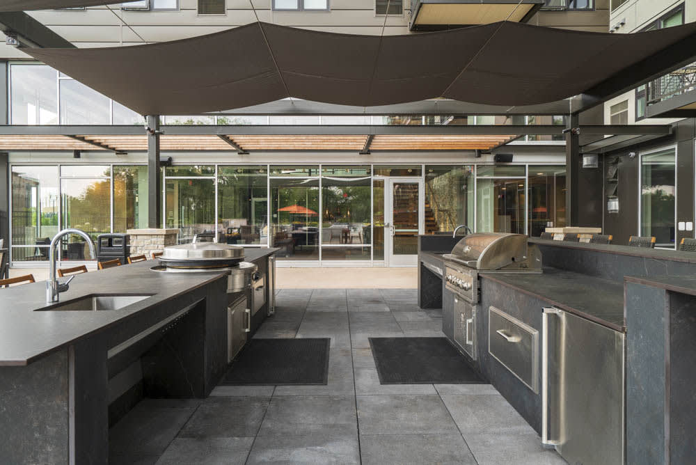 Dual grills as an outdoor amenity.