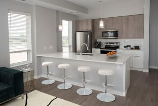 Joel 1 bedroom kitchen with seating at bar area