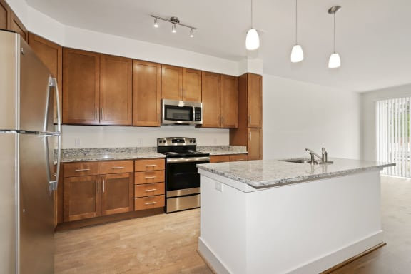 A2A Kitchen with wooden closet at Avenue Grand, Maryland