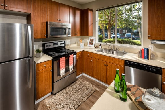Kitchen with stainless steel refrigerator, granite countertops and faux hardwood floors