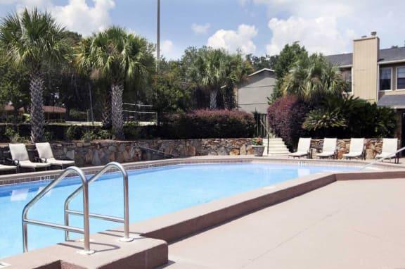 Swimming Pool With Relaxing Sundecks at Jasmine Creek Apartments, Pensacola, Florida