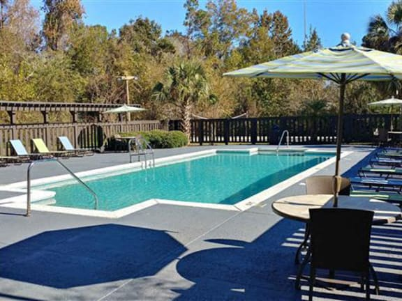 Lounge Chairs At Pool at Springwood Townhomes Apartments, Tallahassee