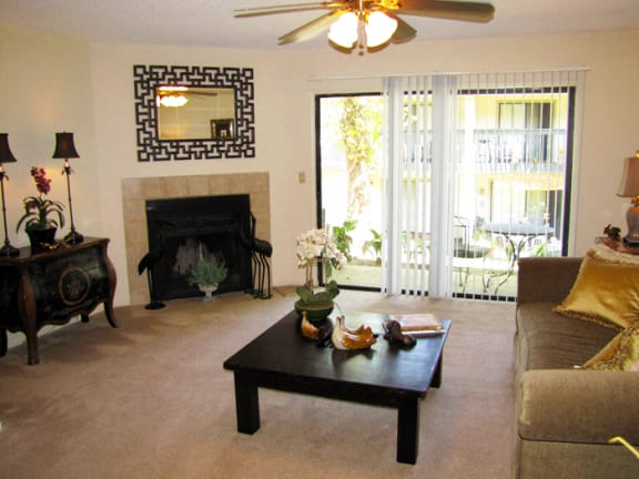 Living room with fireplace at Laurel Grove Apartment Homes, Florida