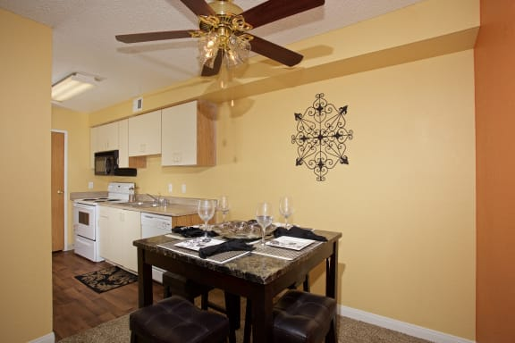 Dining Kitchen With Ceiling Fan at Sky Court Harbors at The Lakes Apartments, Las Vegas