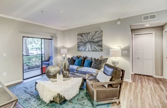 spacious living room with crown molding at the preserve at westchase, tampa fl