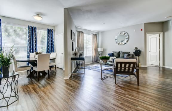 spacious living room with hardwood floor at tuscany bay apartments, westchase tampa fl