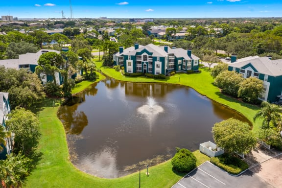 Aerial View Of Apartment Homes Overlooking The Pond & Fountain