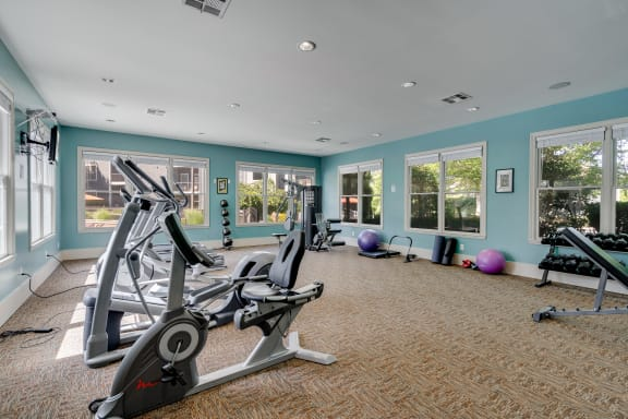 Fitness Center Overlooking The Pool Deck