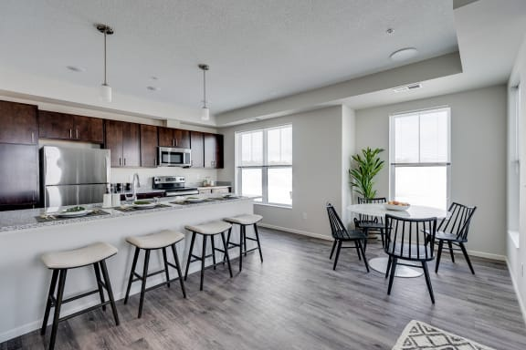 Expansive Granite Kitchen Island With Four Bar Stool Seats