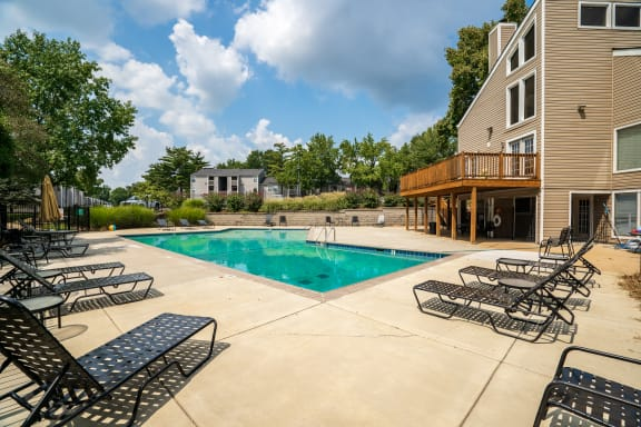 Pool & Sundeck With Lounge Chairs