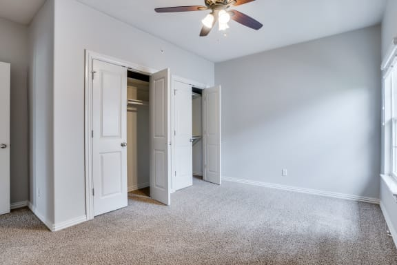 Carpeted Bedroom With Dual French Closet Doors
