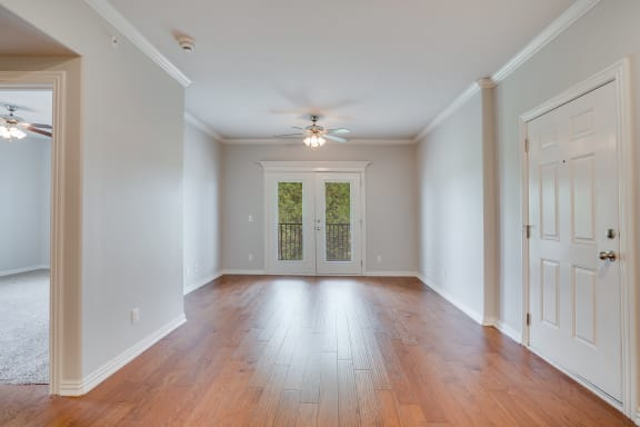 Spacious Living Room With Hardwood Floors & French Patio Doors