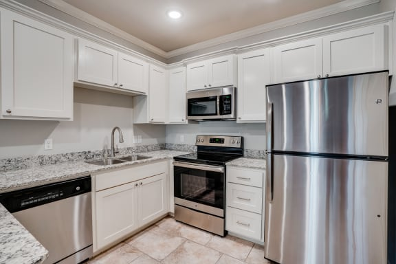 Kitchen With Stainless Steel Appliances & Tiled Flooring