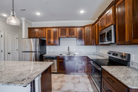 Kitchen Featuring Tile-Style Flooring With Lots Of Cabinetry