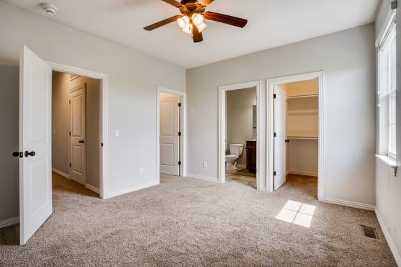 Carpeted Bedroom With Ceiling Fan & Light