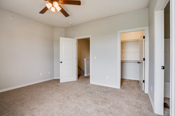 Carpeted Bedroom Featuring Two Walk-In Closets
