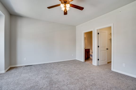 Carpeted Bedroom With Tall Ceilings
