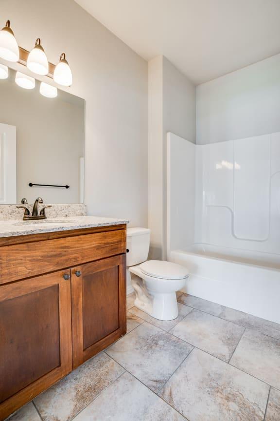 Bathroom With Tile-Style Flooring