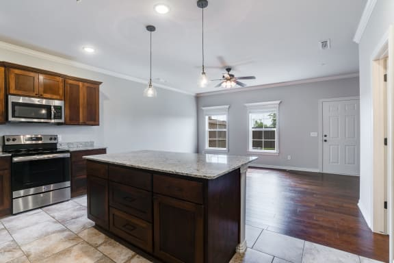 Kitchen With Large Granite Countertop Island