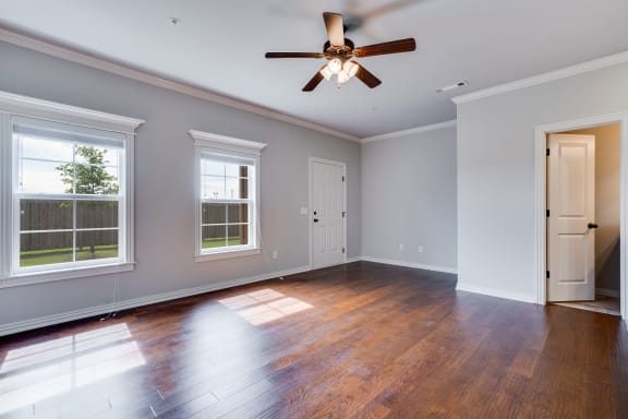 Large Living Room With Wood-Style Flooring and Large Windows