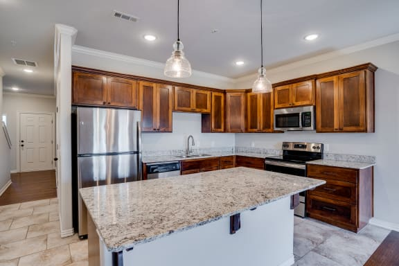Kitchen With Stainless Steel Appliances & Granite Countertops