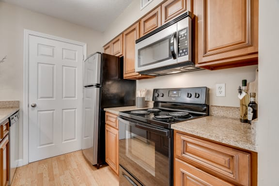 Kitchen With Black & Stainless Steel Appliances