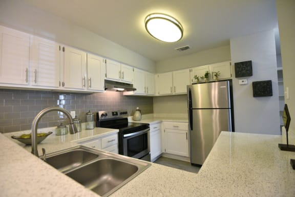 large kitchens with ample storage and all of the upgrades
