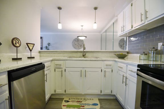 upgraded kitchen with white cabinets