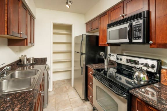 Gorgeous kitchens with backsplash, stainless steel appliances and large pantries