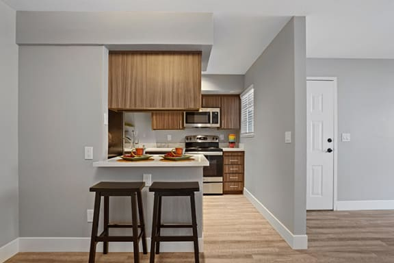 Fitted Kitchen With Island Dining at Clayton Creek Apartments, California