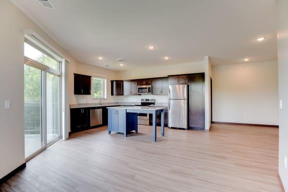 large kitchen with accent island at Lake Jonathan Flats, Chaska, Minnesota