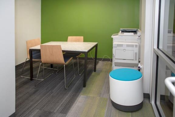 study lounge with printer, copier and white board wall.