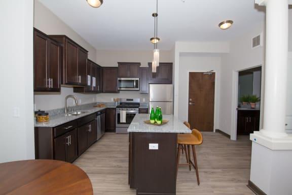 Enjoy light colored granite kitchen counter tops at Birdtown Flats, Robbinsdale, MN