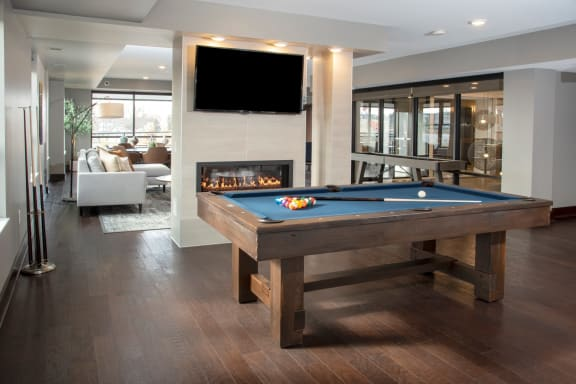 pool table, tv, fireplace in community room