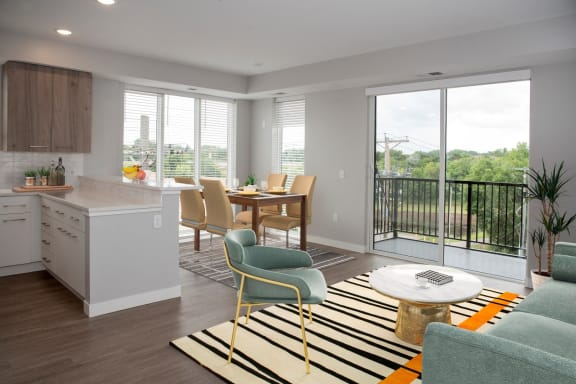 Marc 2 br floor plan with living and dining areas and balcony